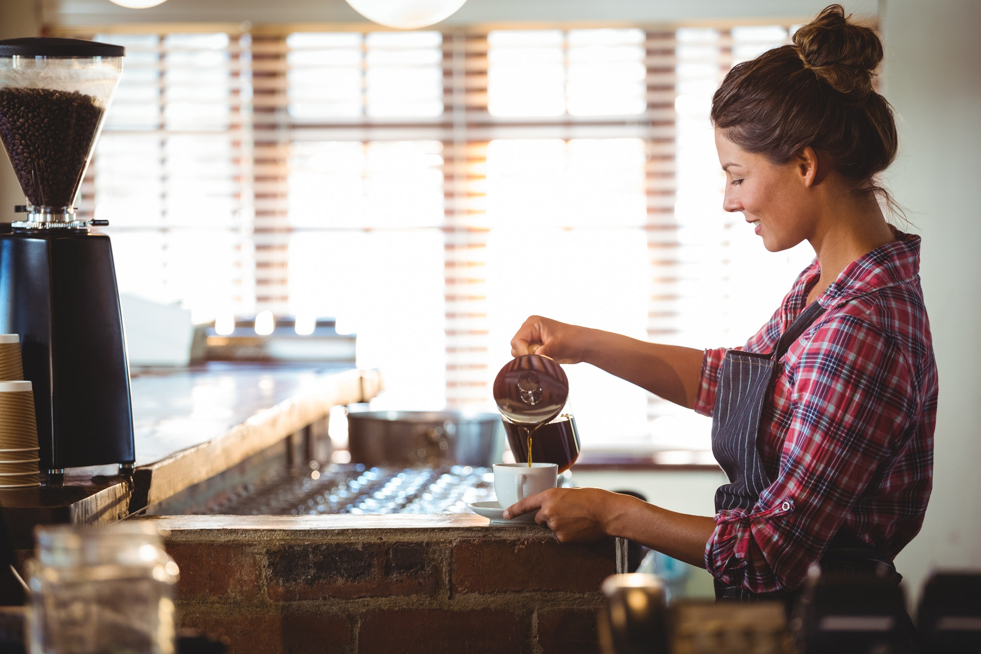 Waitress preparing a coffee